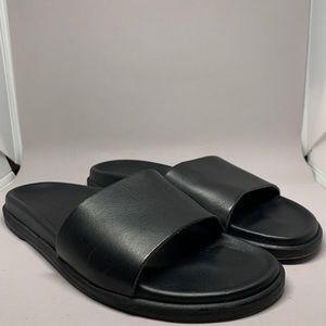 Kyma black leather slip on sandals